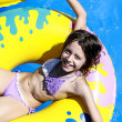 Beautiful young girl having fun in aquapark — Stock Photo