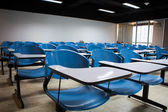 Blue chairs in empty classroom — Foto Stock