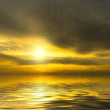 Very bright sunset. The sun is absorbed by dramatic clouds — Stock Photo