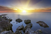 Sunset over the silky water with rocks — Stock Photo
