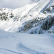 Cluster of chalets on a snowy mountain slope — Stock Photo