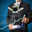 Businessman analysis graph with world of finanec — Stock Photo