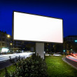 White display advertising with traffic at night — Stock Photo
