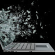 Laptop with broken screen isolated on black background — Stock Photo