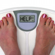 Feet on a bathroom scale - isolated — Stock Photo