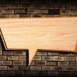 Retro speech bubbles from splat on old brick wall — Stock Photo