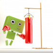 Green cute toy hits the boxing pear  Boxing android — Stock Photo