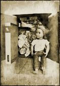 An old doll in a cardboard box — Stock Photo