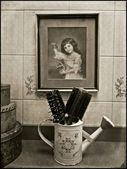 Brushes and an old painting. — Stok fotoğraf