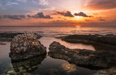 Sunset over the Sea and Rocky Coast with Ancient Ruins — Stock Photo
