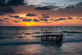 Tropical Beach with Empty Cage in the Sea at Sunset — Stock Photo