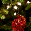 Toy heart on the chrismas tree — Stock Photo