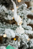 Funny doll on the christmas tree — Stock Photo