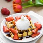 Waffles with ice cream, chocolate sauce and strawberries — Stock Photo #42199669
