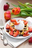 Waffles with ice cream, chocolate sauce and strawberries — Stock Photo