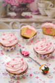Vanilla cupcakes with pink curd and pink frosting. — Stock Photo