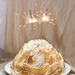 Baked brownie dough Alaska with cherry ice cream and Bengal lights. — Stock Photo