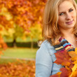 Beautiful autumn woman in golden park — Stock Photo