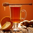 Winter tea with honey on a wooden table — Stock Photo