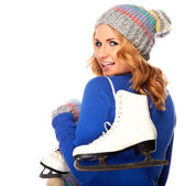 Beautiful happy young woman goes ice-skating — Stock Photo