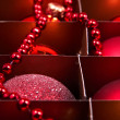 Golden and red christmas balls in box — Stock Photo