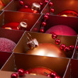 Golden and red christmas balls in box  — Photo