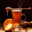 Winter tea with honey and orange on a wooden table — Stock Photo
