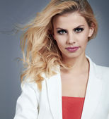 Beautiful young woman with blonde hair. Pretty model poses at st — Stock Photo
