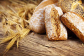Bread and wheat on the wooden — Stock Photo