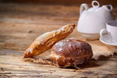 Morning breakfast - tea and doughnut on wooden table — Stockfoto