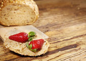 Fresh strawberries on a slice of bread — Stock Photo
