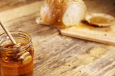 Breakfast with honey, healthy food on wooden table — Stockfoto