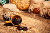 Fresh dried Plums and preserves — Stock Photo
