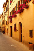 Vintage street decorated with flowers, Tuscany, Italy  — Stock Photo