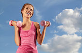 Pretty young woman exercising with small weights — Foto de Stock
