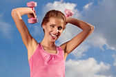 Pretty young woman exercising with small weights — Stock Photo