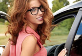 Successful young woman in the car — Stock Photo