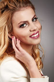Beautiful young smiling woman with blonde hair  — Stock Photo