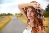 Beautiful young woman traveling — Stock Photo