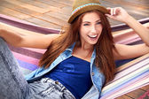Beautiful young woman resting in a hammock — Stockfoto