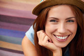 Smiling girl in hat — Stock Photo
