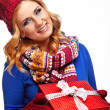 Christmas gift. Surprised beautiful girl — Stock Photo #51455357