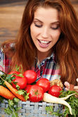 Beautiful woman with vegetables in the garden — Stock Photo