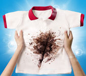 Hand hold dirty shirt — Stock Photo