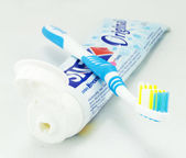 Toothbrush and toothpaste tubes — Stock Photo