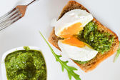 Toast with pesto and with egg — Stock Photo