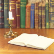 Book and candle — Stock Photo