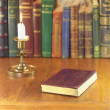 Stock Photo: Old book and candle
