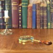 Magnifier and candlestick — Stock Photo