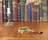 Magnifier and candlestick — Photo